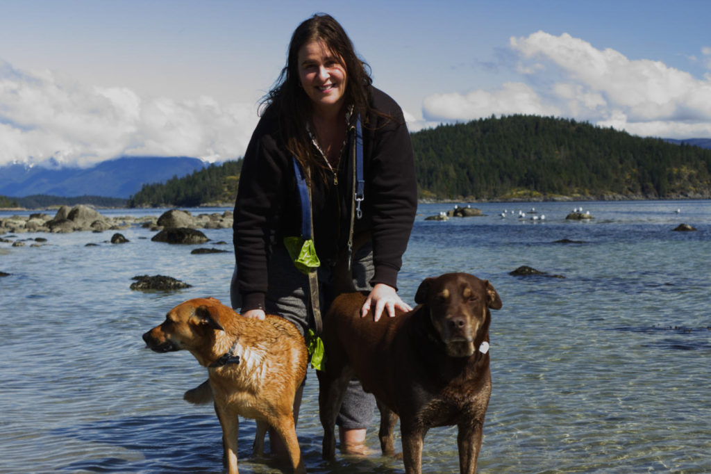 Sara and her dogs at the beach