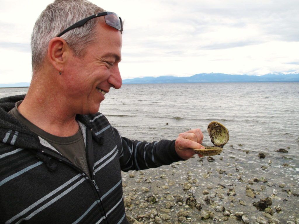 Warren at Smelt Bay holding a clam